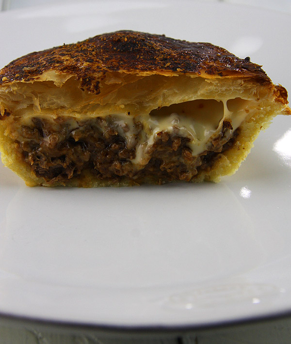 meat pie with melted cheese
